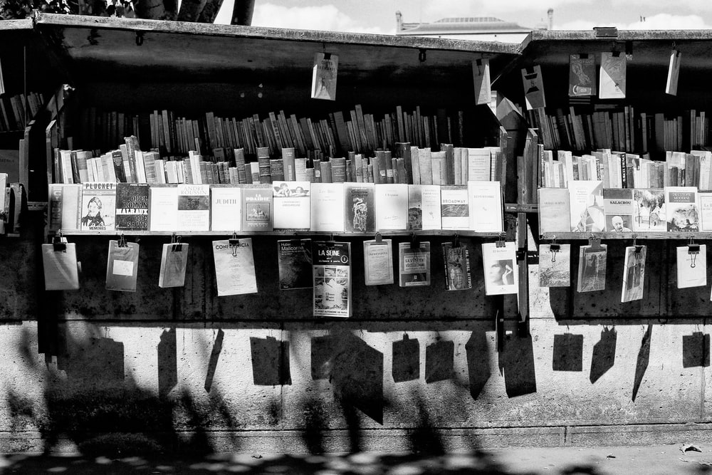 grayscale photo of book lot