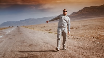 man walking on desert kazakhstan teams background