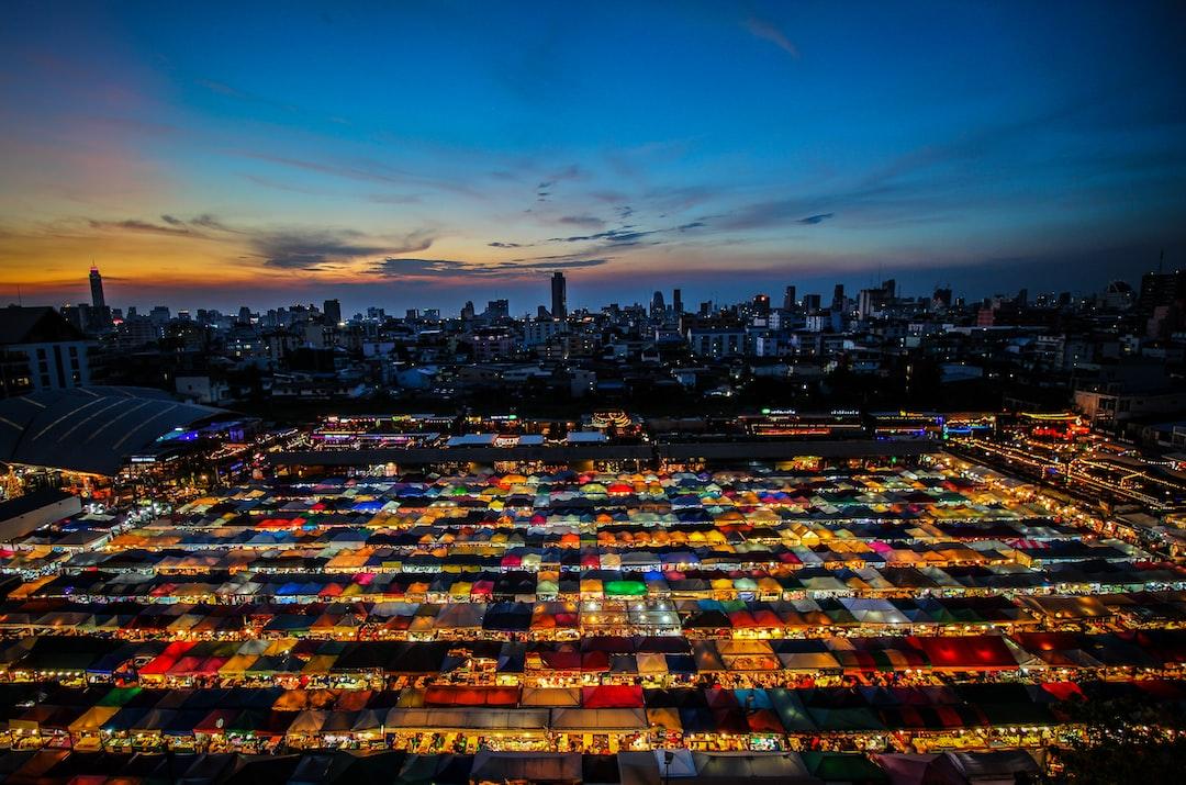 Sunset over a night market in Bangkok
