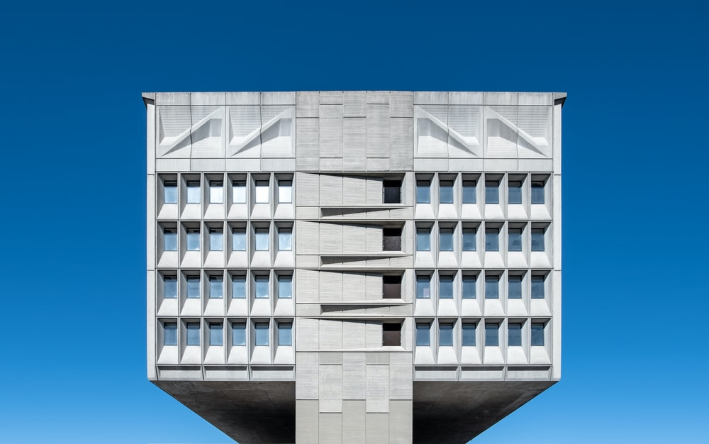 white and gray concrete building during daytime