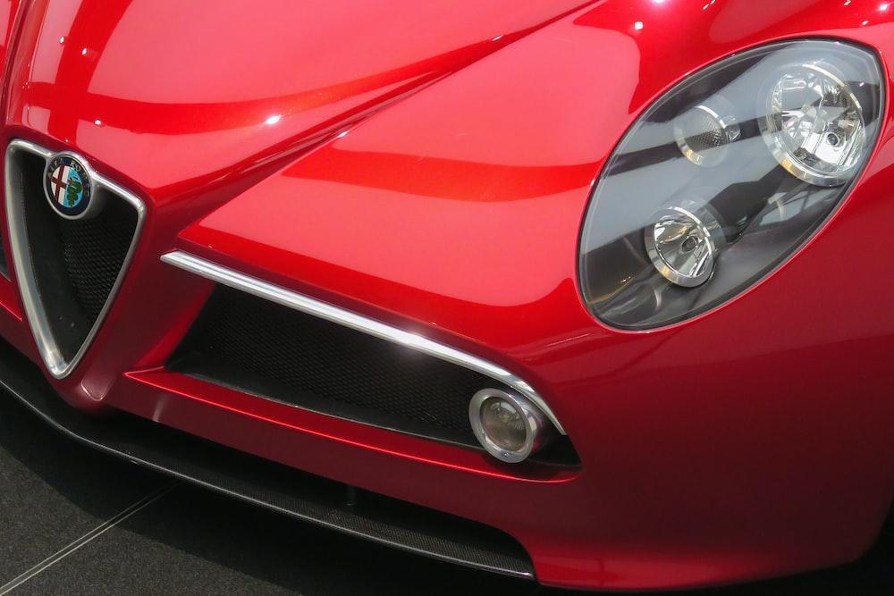 closeup photo of red Alfa Romeo vehicle
