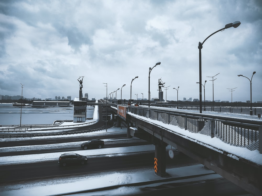 bridge covered with snow viewing sea