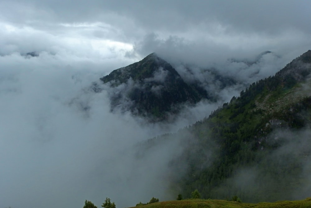 mountains covered with clouds during daytime
