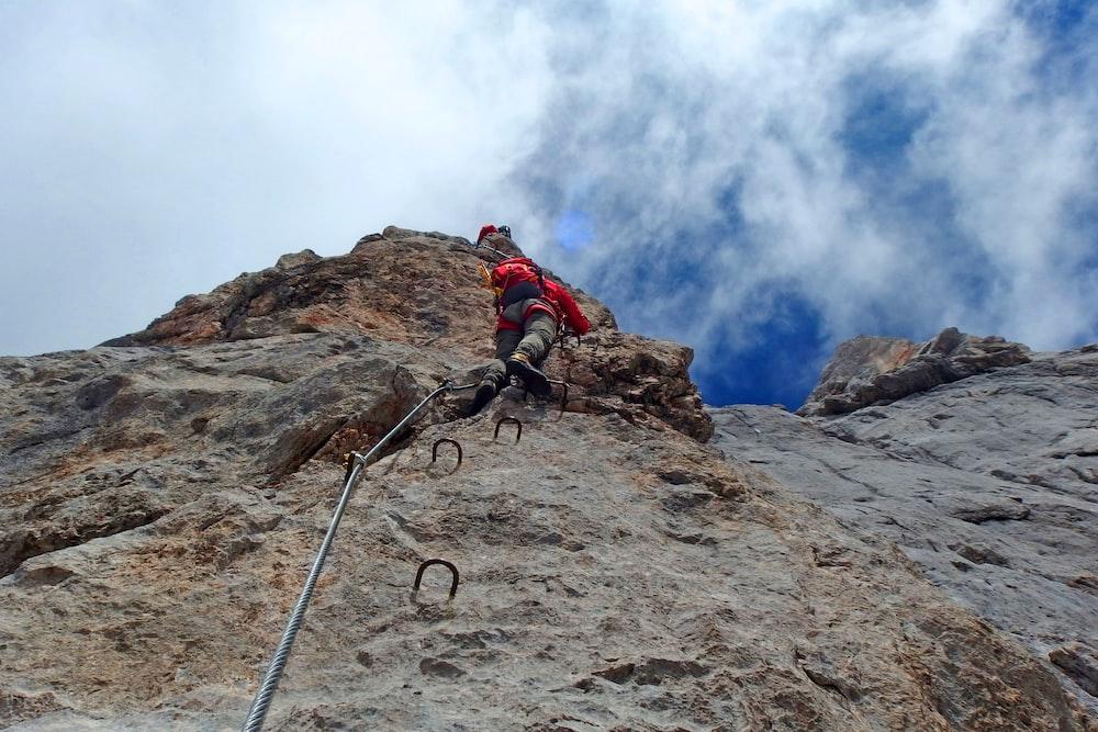 man mountain climbing
