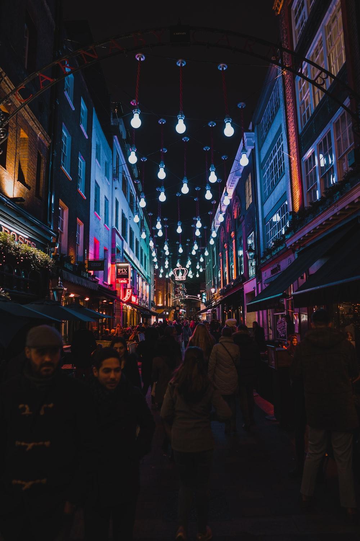 people waking between buildings during night
