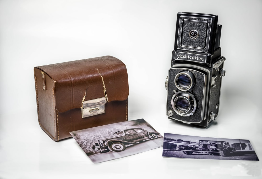 vintage camera with brown leather case
