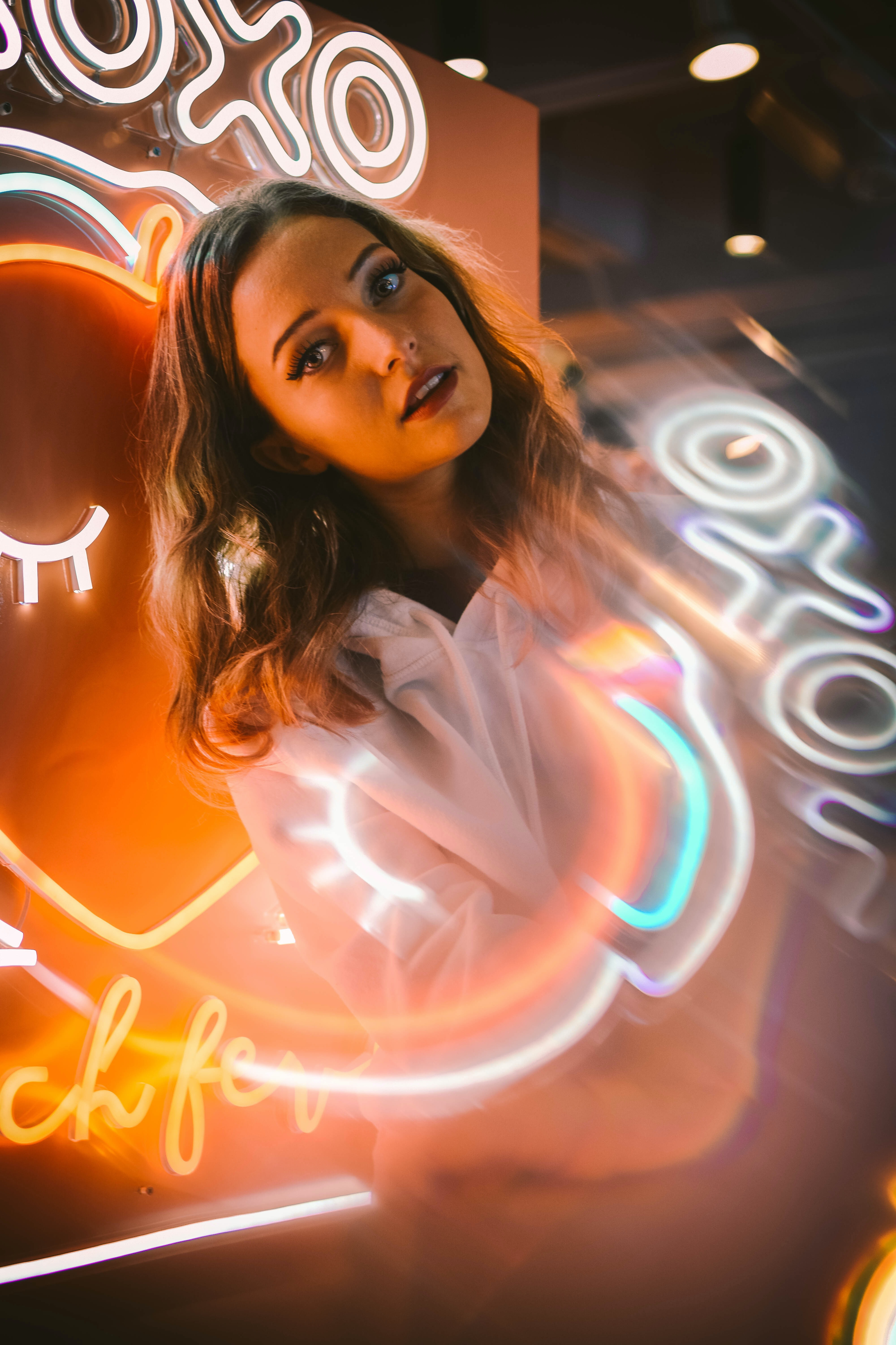 woman in white top in lighted decor