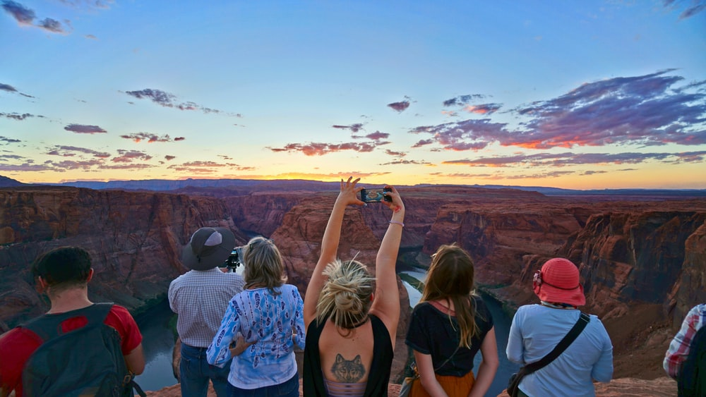 woman taking picture of Horseshoe Bend Arizona