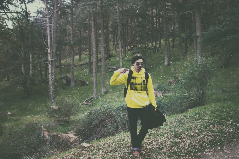 man wearing yellow pullover hooded jacket