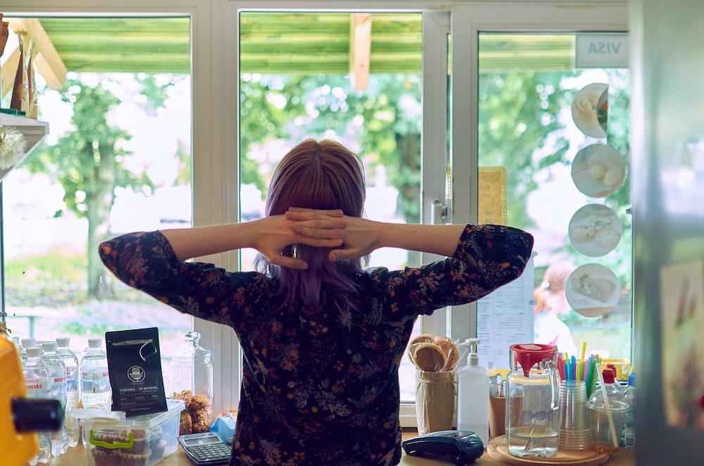 woman facing glass window
