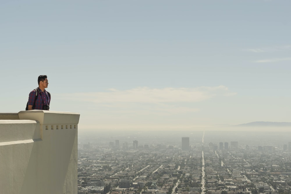 man standing at roof top