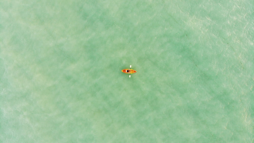 aerial view of boat on body of water