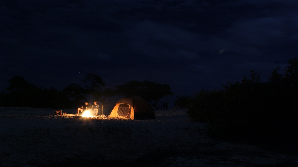 ighted camping tent at night