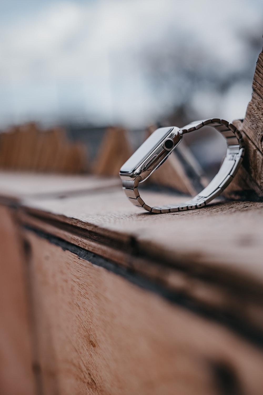 silver aluminum case Apple Watch on floor