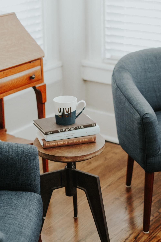 white ceramic mug on book