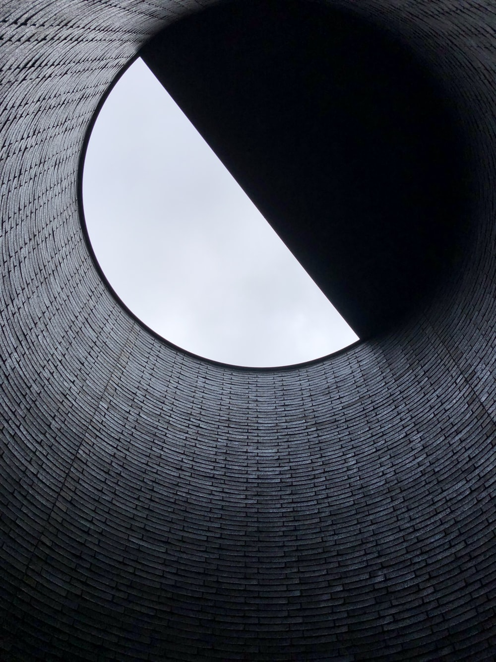 low-angle photography of hole
