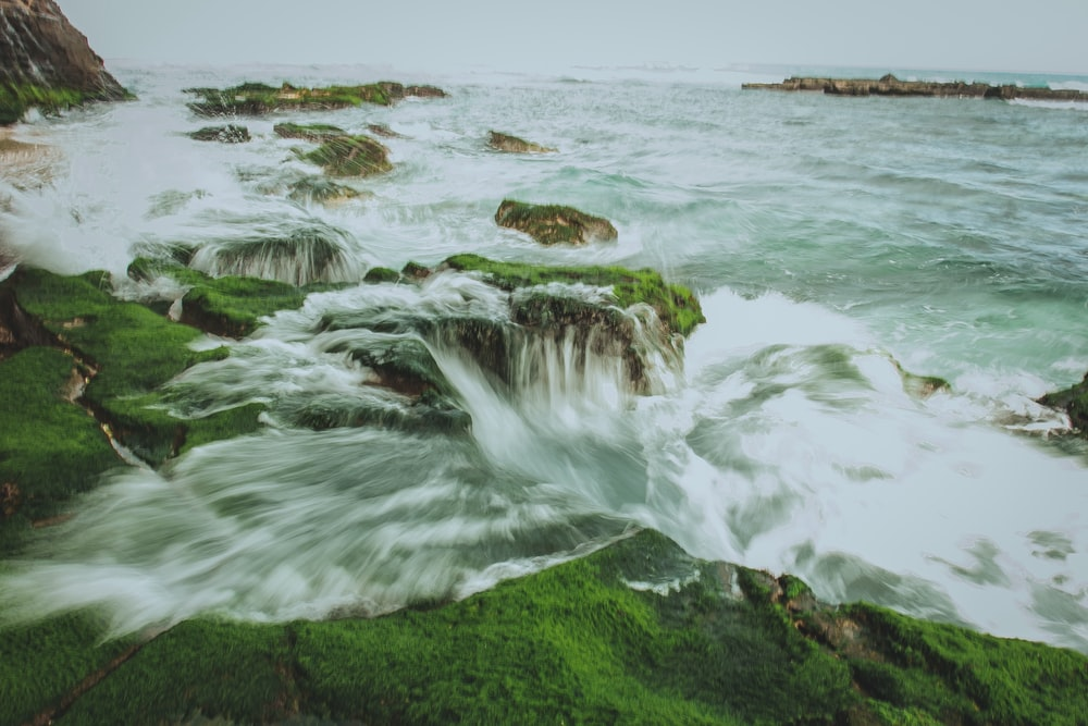 time lapse photo of sea water waving on high ground