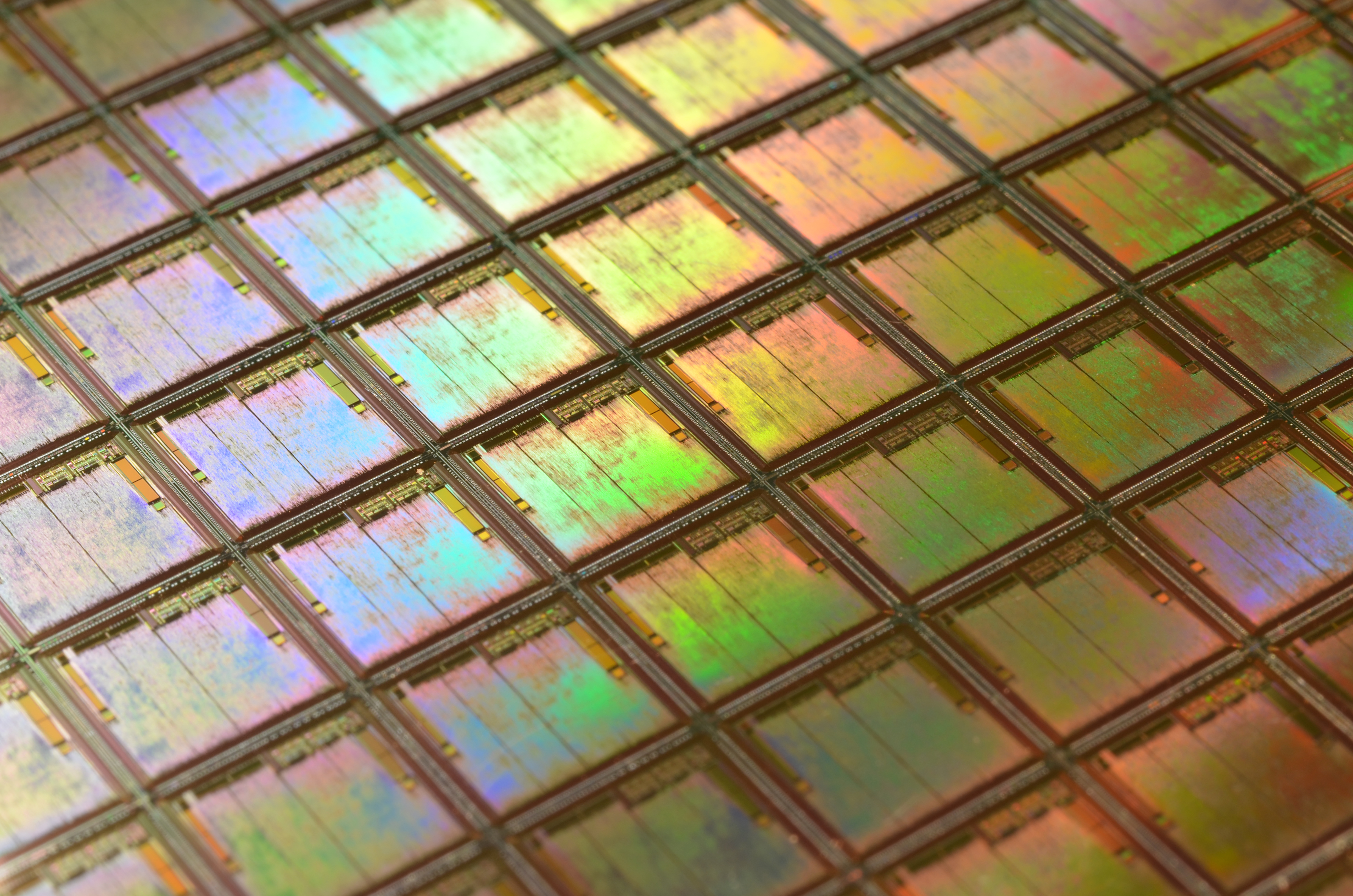 """""""This is a macro of a silicon wafer. Each square is a chip with microscopic transistors and circuits. Ordinarily, wafers like these are diced into their individual chips and the chips go into the processors that power our computers.\r\nSometimes, wafers have flaws and the manufacturers dispose of them instead. That\u2019s how I got mine. After visiting the tech museums in Silicon Valley, I was amazed at the beauty of silicon wafers, so I started collecting and photographing them.\r\nLike fractals and flowers, the closer you get to them, the more amazing details there are to see."""""""