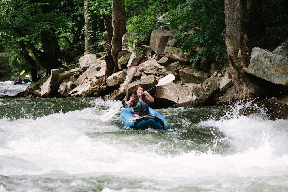 woman kayaking on rapids