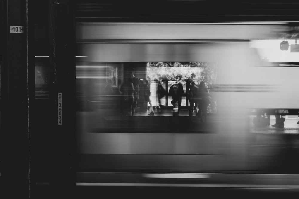 grayscale photography of photo displayed on glass window of store