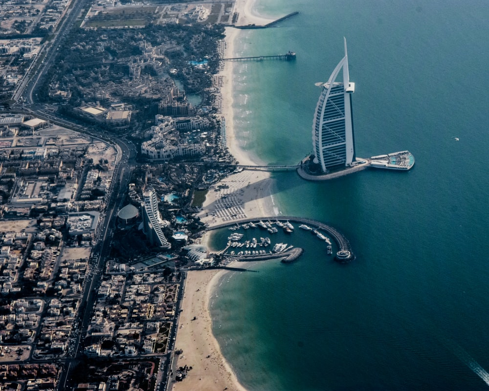 aerial photography of Burj Al-Arab near seashore