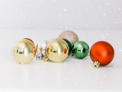 assorted-color baubles on white surface christmas eve zoom background