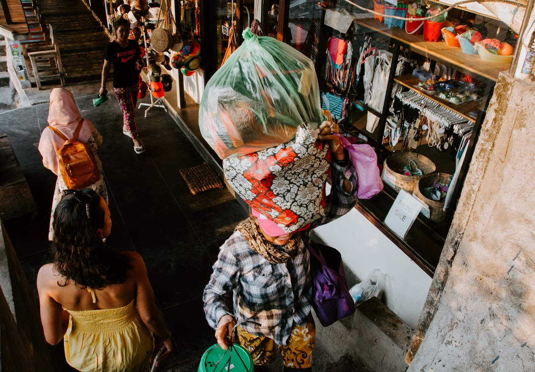 I snapped this photo near Suluban Beach in Bali. The batik cloth wrapping the items that the lady was carrying on her head caught my eye.  Added tag for International Women's Day 2019.