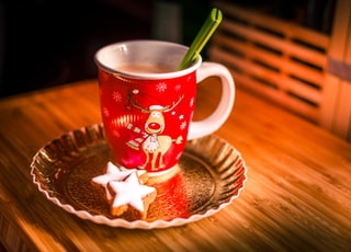 white and red mug