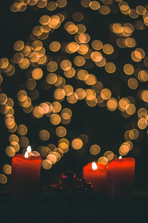 three lighted pillar candles
