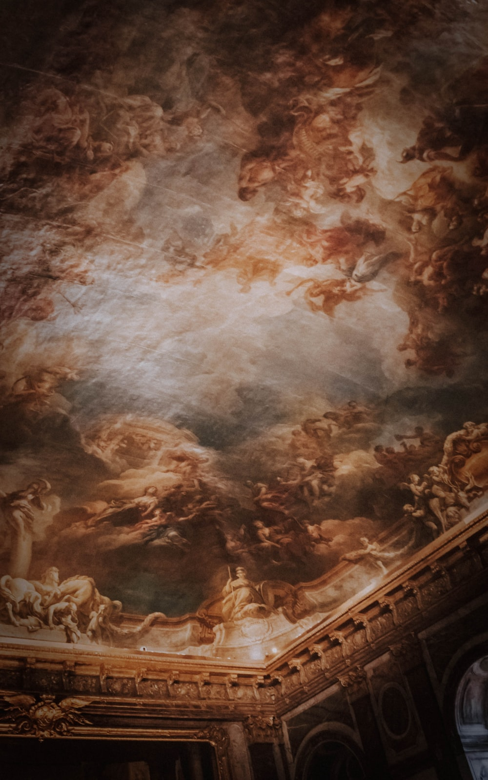 brown and white ceiling art