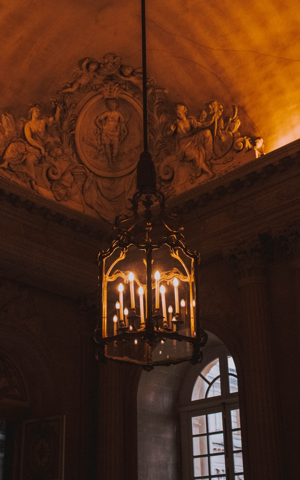 brass glass covered chandelier lighted up