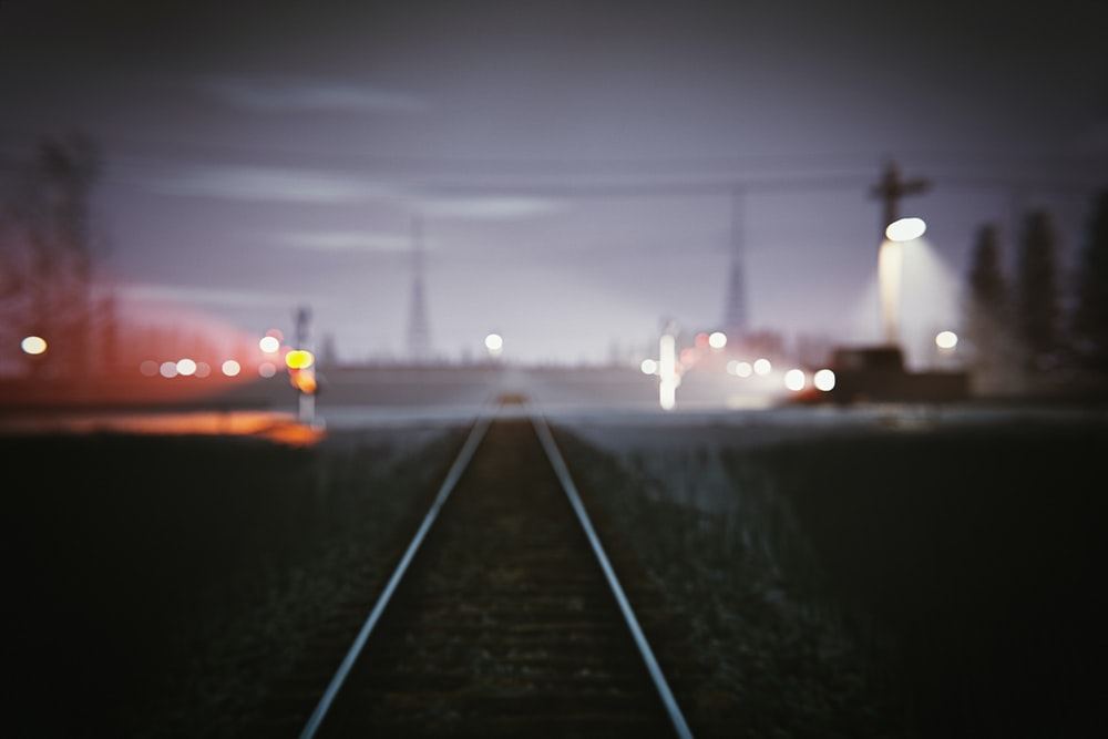 bokeh photography of railway