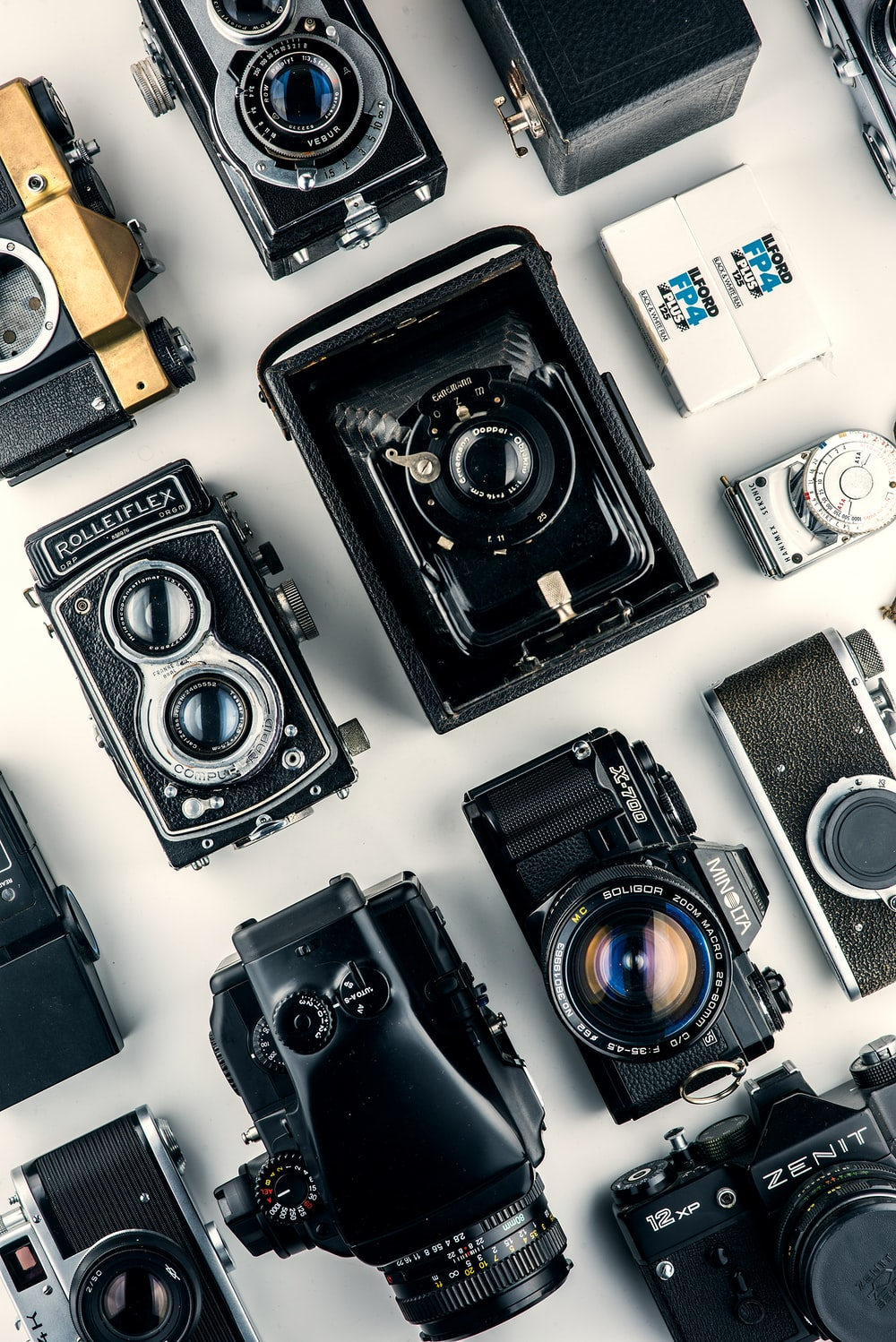 black cameras on white surface
