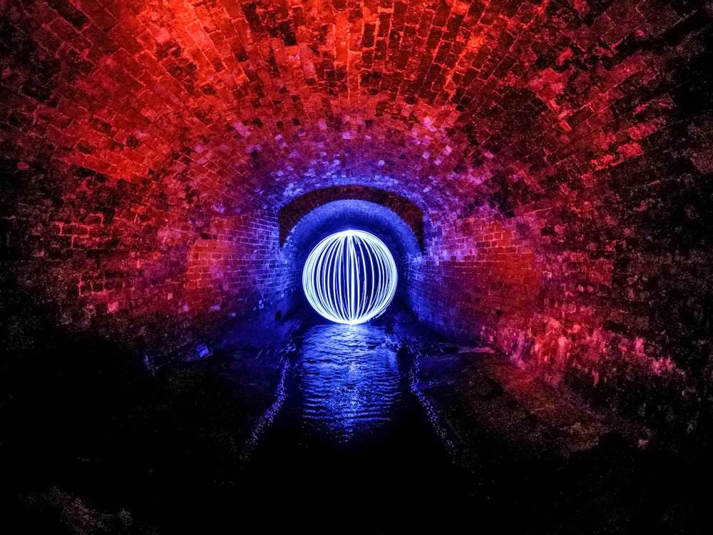 lighted ball inside tunnel