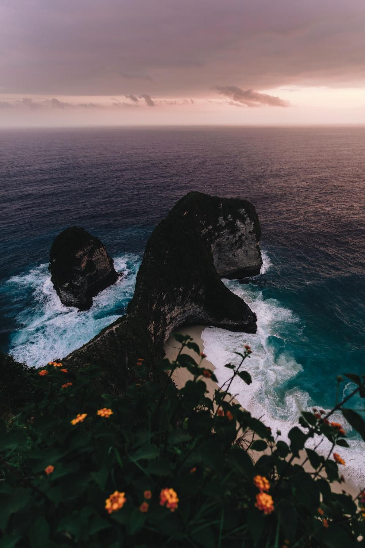 rocky beach cliff viewing calm sea