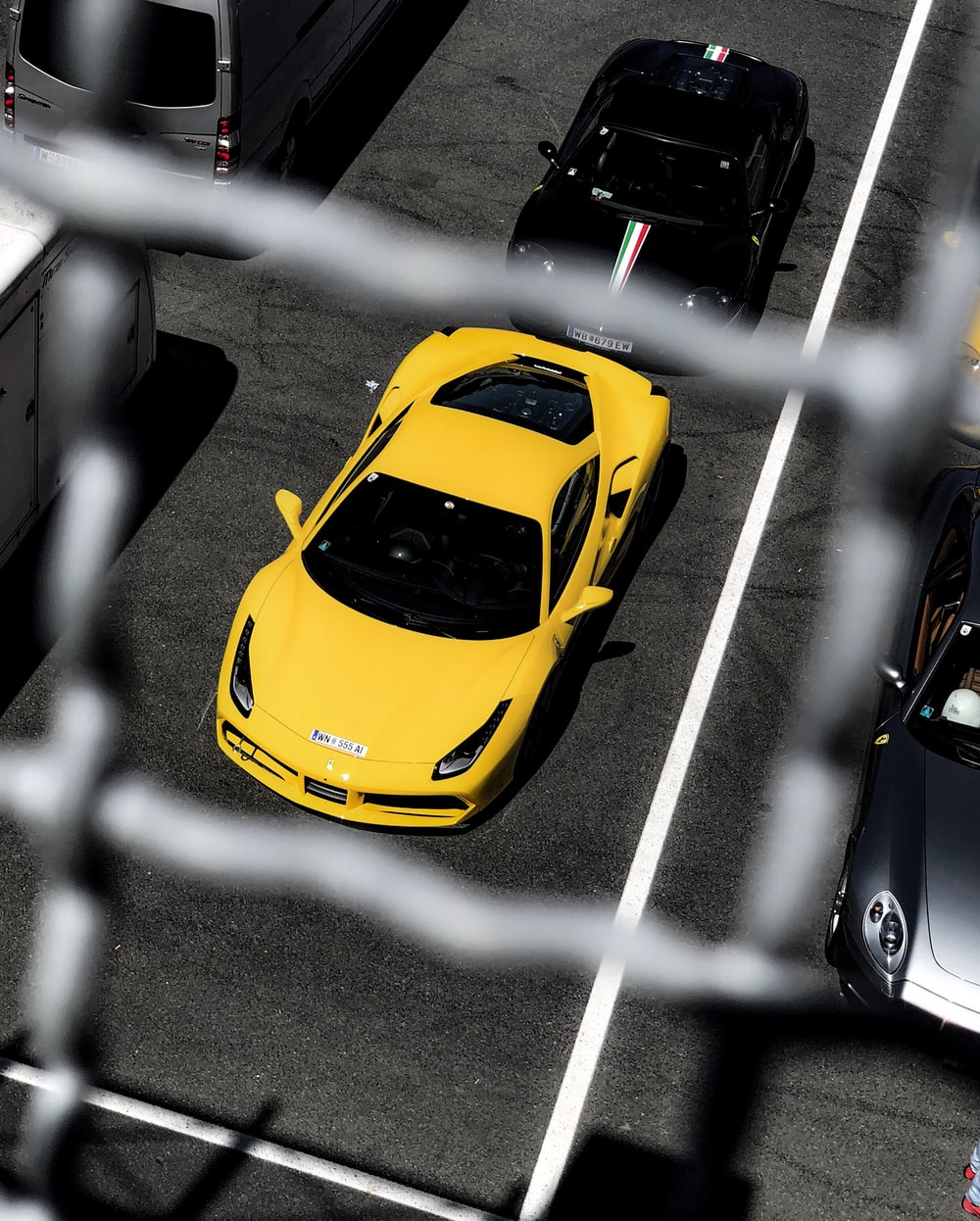 selective focus photography of yellow and black luxury cars