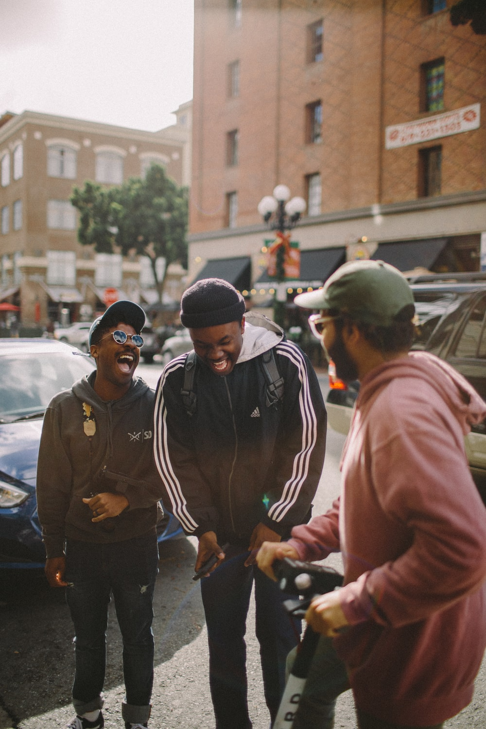 three men in jacket laughing at each other