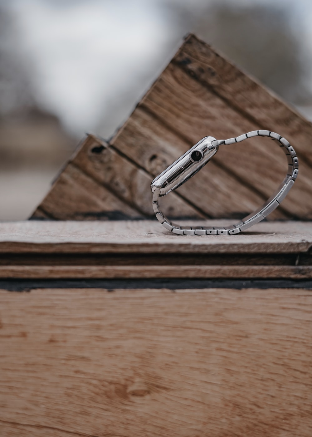 silver smartphone with link bracelet