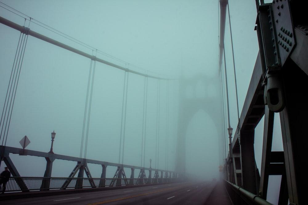 fog covered steel bridge