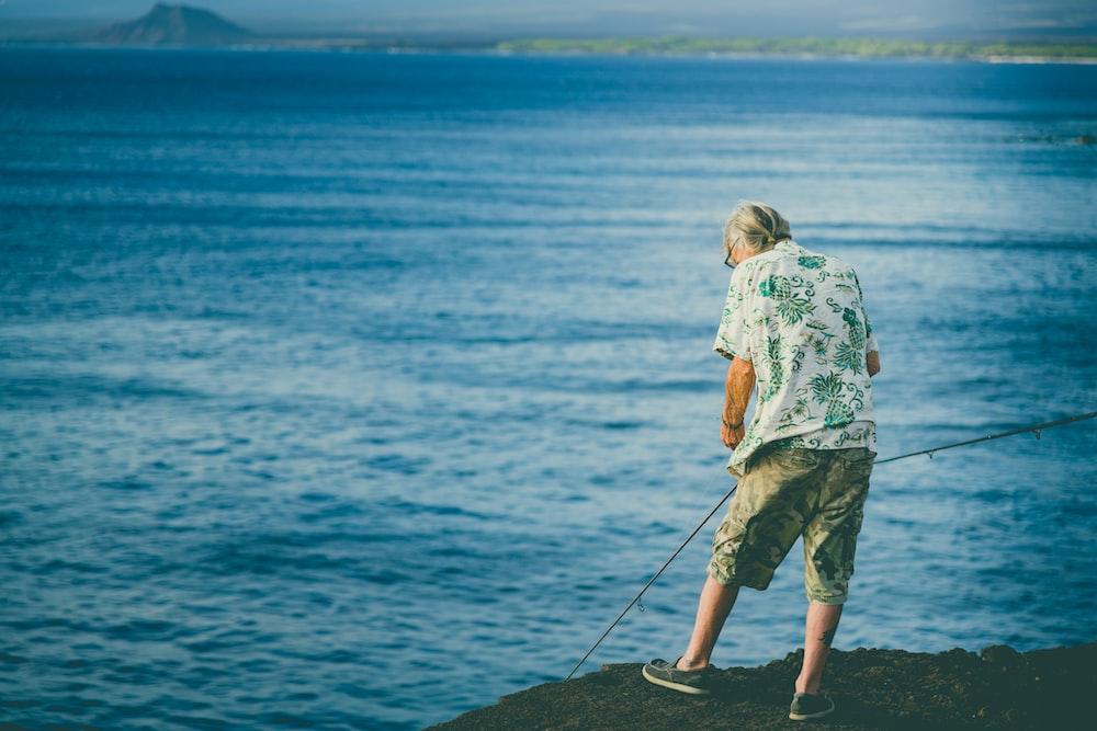man standing on the seashore
