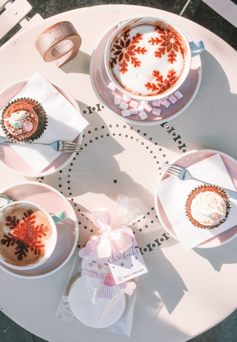 cupcakes and coffee cups at table