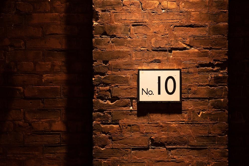 no. 10 sign on brick wall