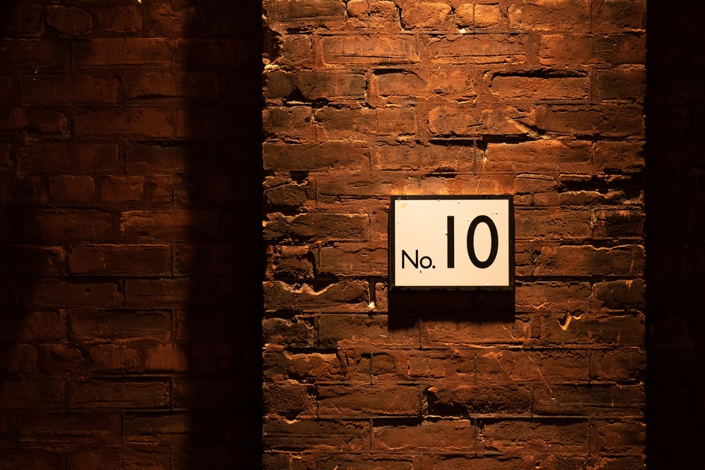 no. 10 sign on brick wall