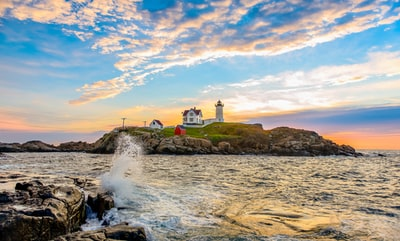 lighthouse on islet maine teams background
