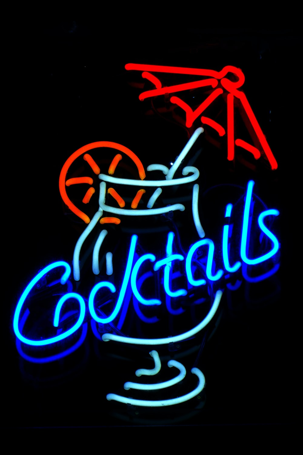 blue and red cocktails neon signage