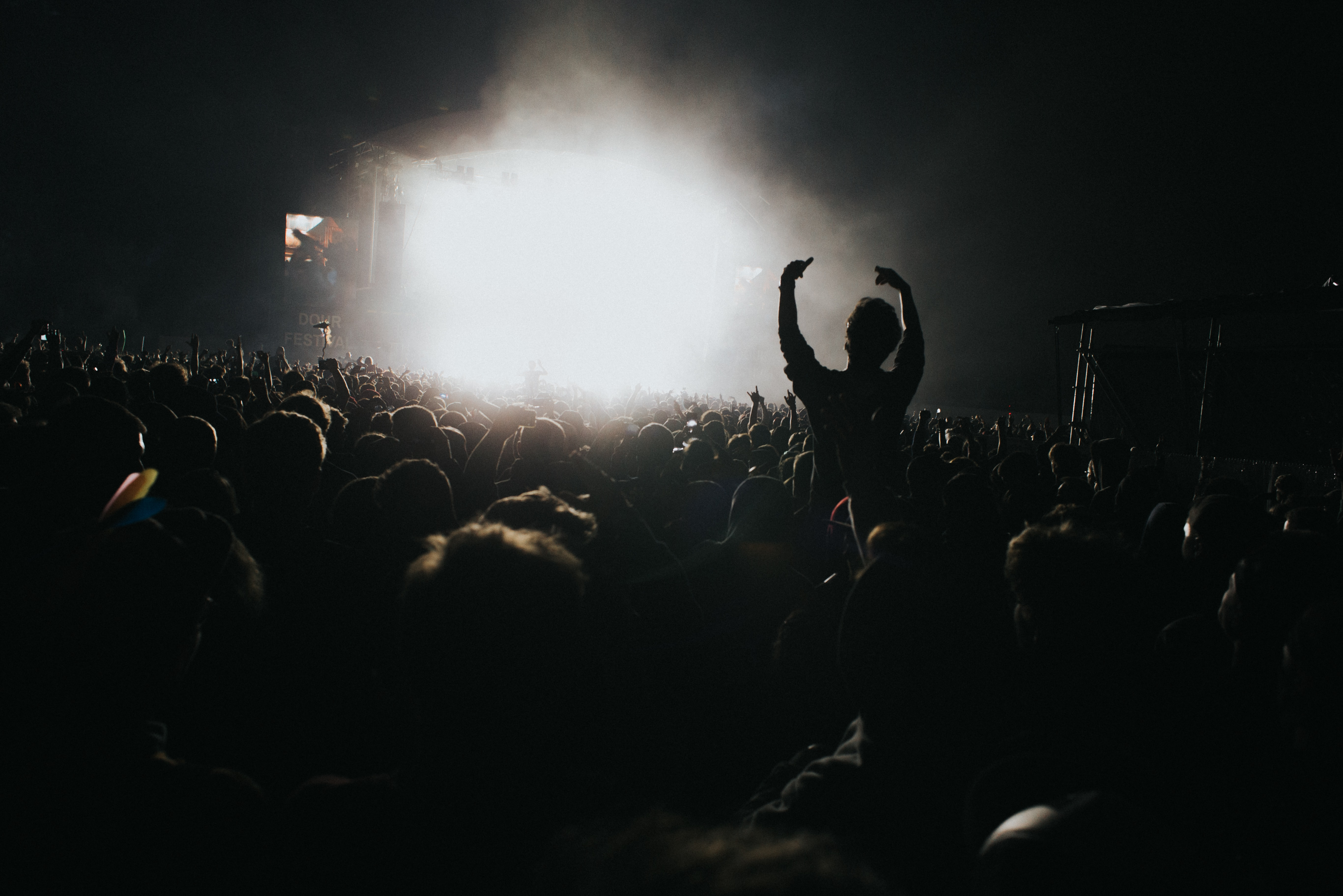 silhouette photography of people in concert