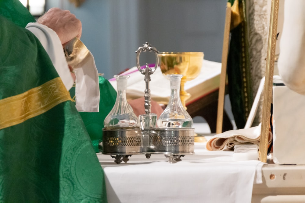 priest wiping chalice