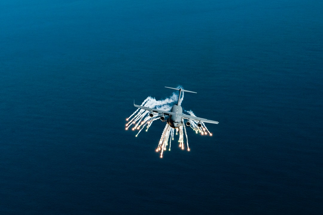 A C-17 Globemaster III aircraft deploys flares off the coast of Charleston, SC.