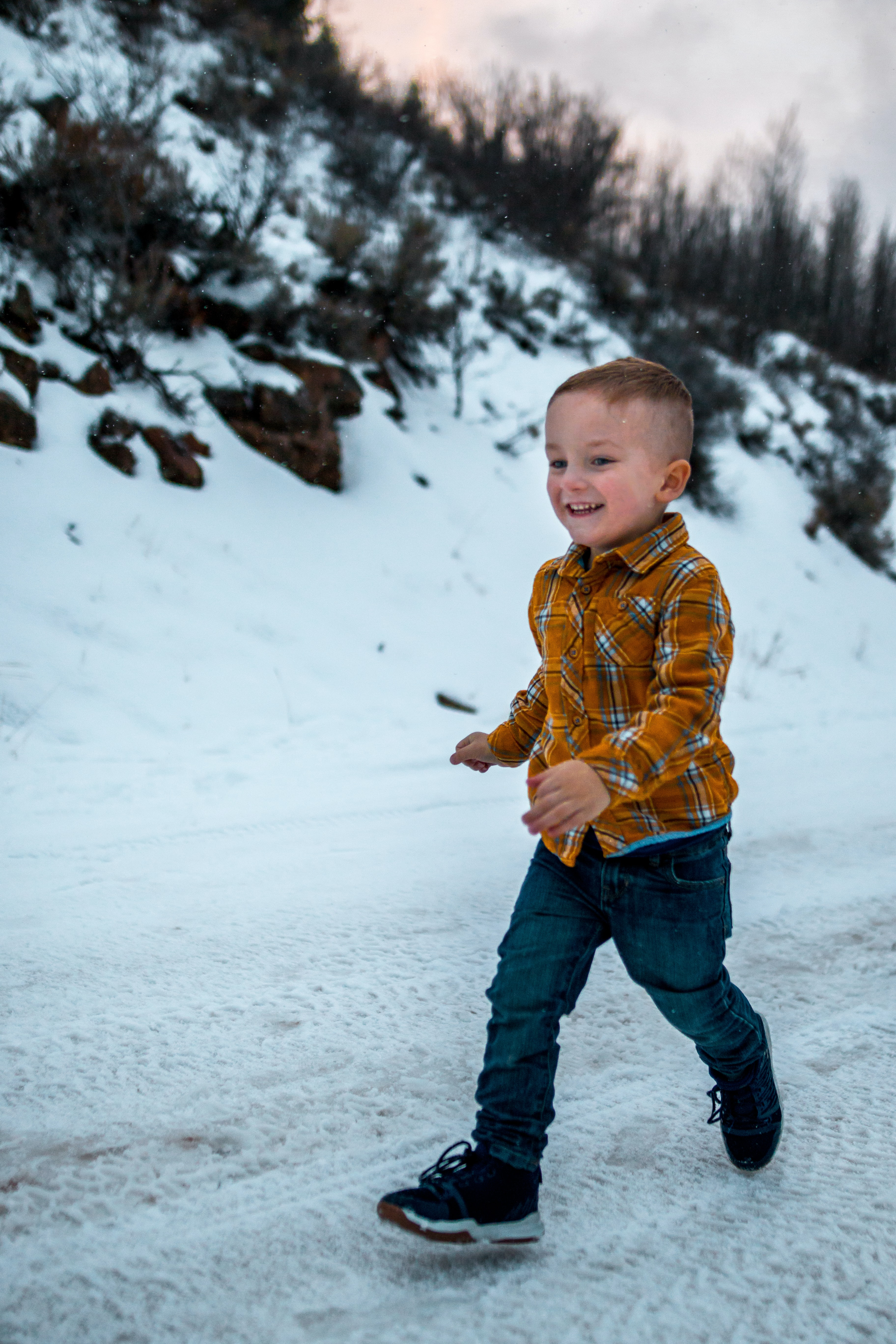 boy walking on snow
