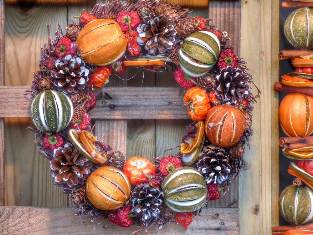 closeup photo of brown, green, and maroon floral door wreath